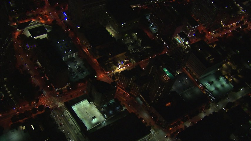 HD stock footage aerial video reverse view of rooftop hotel pool and street at night, Midtown Atlanta, Georgia Aerial Stock Footage | CAP_013_040