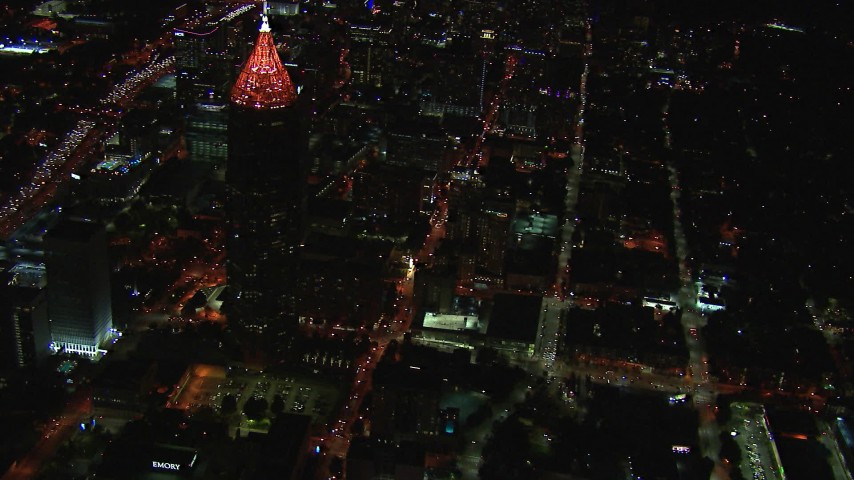 HD stock footage aerial video reverse view of streets by Bank of America Plaza at night, Midtown Atlanta, Georgia Aerial Stock Footage | CAP_013_041
