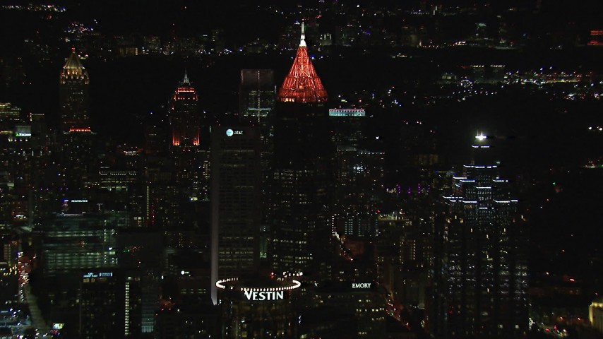 HD stock footage aerial video reverse view of Bank of America Plaza seen from downtown at night, Midtown Atlanta, Georgia Aerial Stock Footage | CAP_013_043