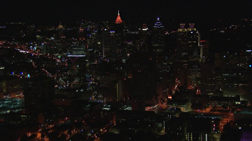 HD stock footage aerial video reverse view of the downtown skyline at nighttime, Downtown Atlanta, Georgia Aerial Stock Footage | CAP_013_045