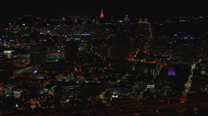 HD stock footage aerial video of flying away from the downtown skyline at nighttime, Downtown Atlanta, Georgia Aerial Stock Footage | CAP_013_046