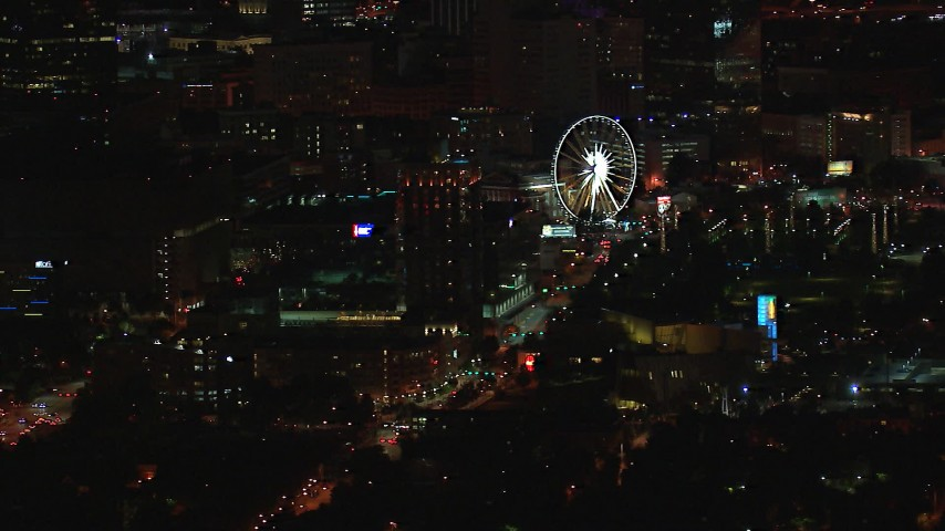 HD stock footage aerial video of a condo complex and Ferris wheel at nighttime, Downtown Atlanta, Georgia Aerial Stock Footage | CAP_013_058