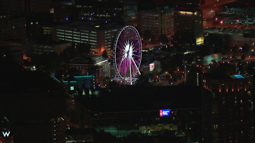 HD stock footage aerial video of flying by a Ferris wheel at nighttime, Downtown Atlanta, Georgia Aerial Stock Footage | CAP_013_061