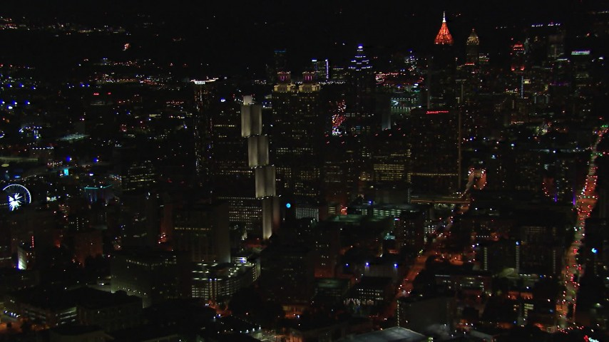 HD stock footage aerial video of a reverse view of downtown's skyscrapers and city buildings at night, Downtown Atlanta, Georgia Aerial Stock Footage | CAP_013_067