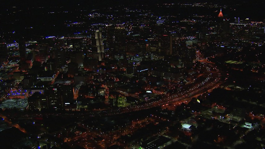 HD stock footage aerial video of approaching downtown's skyscrapers and city buildings at night, Downtown Atlanta, Georgia Aerial Stock Footage | CAP_013_068