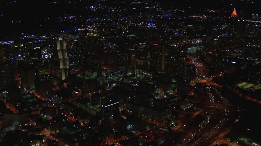 HD stock footage aerial video of an approach to downtown's skyscrapers and city buildings at night, Downtown Atlanta, Georgia Aerial Stock Footage   CAP_013_069