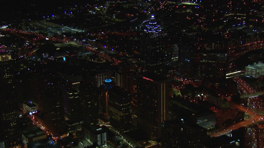 HD stock footage aerial video of an approach to SunTrust Plaza and city buildings at night, Downtown Atlanta, Georgia Aerial Stock Footage   CAP_013_070