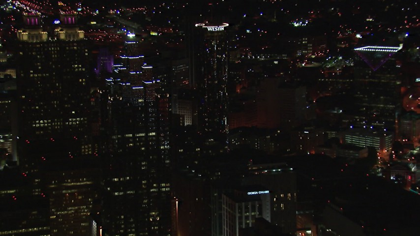 HD stock footage aerial video fly away from SunTrust Plaza and Westin Hotel at night, Downtown Atlanta, Georgia Aerial Stock Footage | CAP_013_073