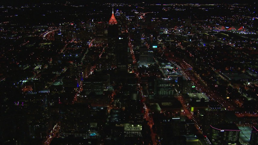 HD stock footage aerial video wide view of Bank of America Plaza at night, Midtown Atlanta, Georgia Aerial Stock Footage | CAP_013_075