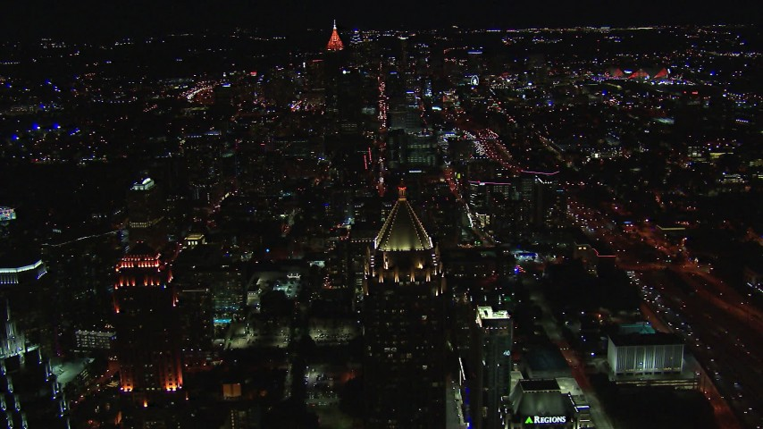 HD stock footage aerial video wide view of Midtown, reveal One Atlantic Center at night, Midtown Atlanta, Georgia Aerial Stock Footage | CAP_013_076