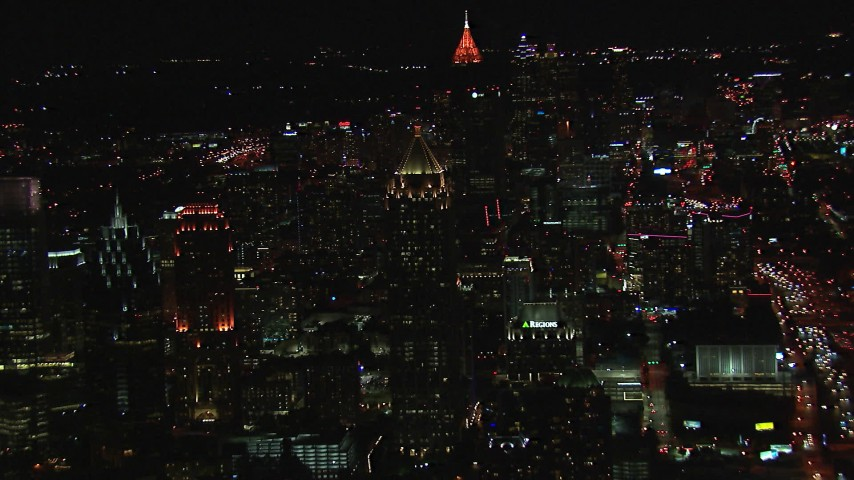 HD stock footage aerial video approach One Atlantic Center, Bank of America Plaza in background at night, Midtown Atlanta, Georgia Aerial Stock Footage | CAP_013_078
