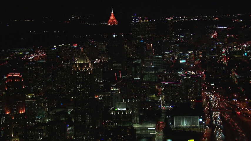 HD stock footage aerial video of a wide view of skyscrapers and city buildings at night, Downtown and Midtown Atlanta, Georgia Aerial Stock Footage | CAP_013_079