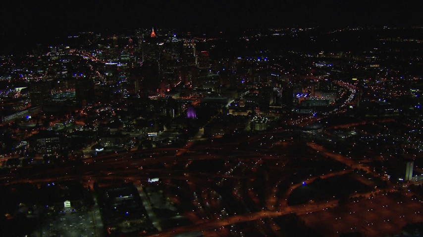 HD stock footage aerial video of flying by the state capitol building and skyscrapers at night, Downtown Atlanta, Georgia Aerial Stock Footage | CAP_013_094