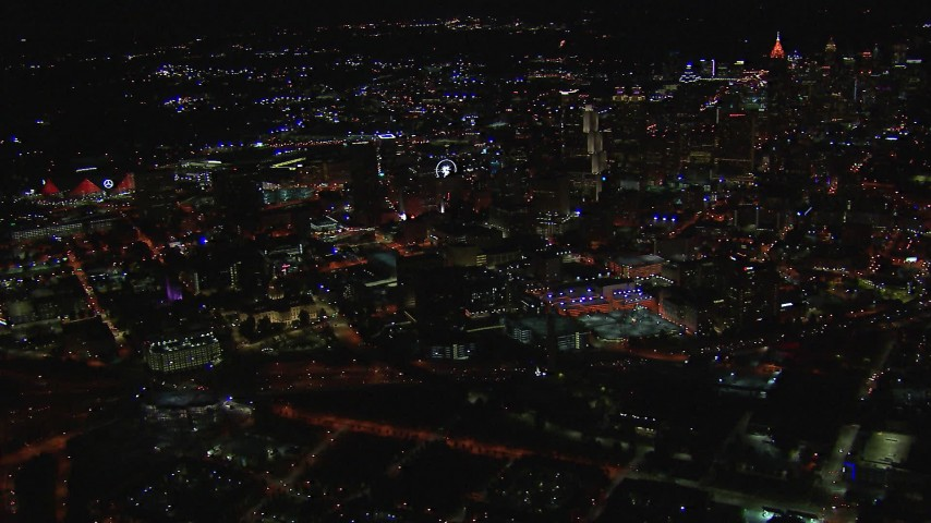 HD stock footage aerial video of a wide view of the state capitol building and skyscrapers at night, Downtown Atlanta, Georgia Aerial Stock Footage | CAP_013_096