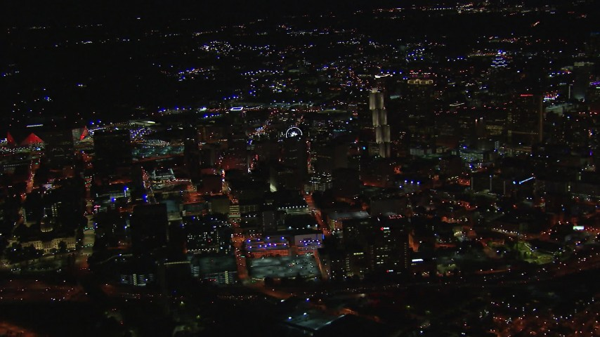 HD stock footage aerial video of a wide view of city buildings and skyscrapers at night, Downtown Atlanta, Georgia Aerial Stock Footage | CAP_013_097