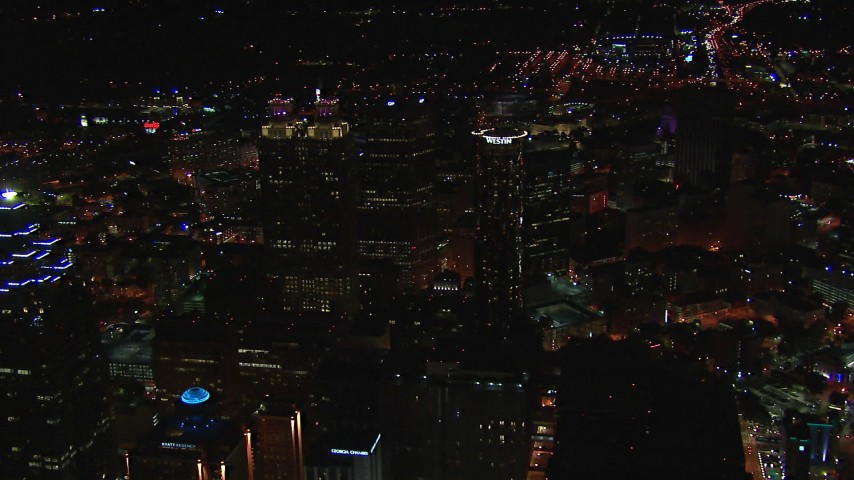 HD stock footage aerial video fly away from tall city skyscrapers at night, Downtown Atlanta, Georgia Aerial Stock Footage   CAP_013_102