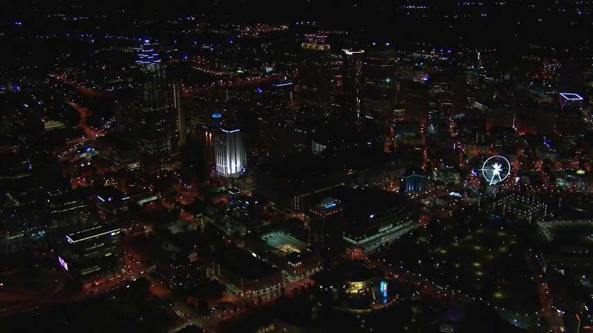 HD stock footage aerial video reverse view of tall city skyscrapers at night, Downtown Atlanta, Georgia Aerial Stock Footage | CAP_013_103