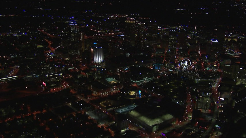 HD stock footage aerial video wide reverse view of tall city skyscrapers at night, Downtown Atlanta, Georgia Aerial Stock Footage | CAP_013_104