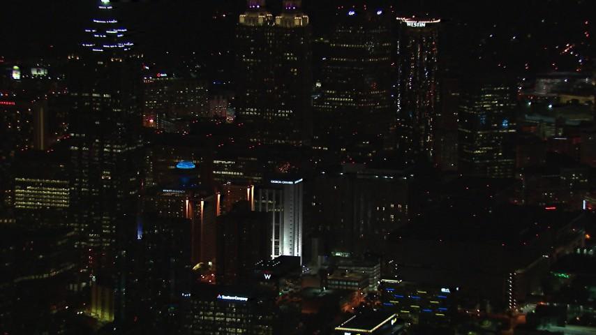 HD stock footage aerial video of skyscrapers towering over city buildings at night, Downtown Atlanta, Georgia Aerial Stock Footage | CAP_013_106