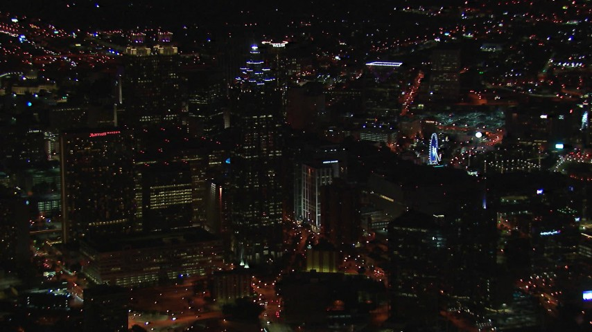 HD stock footage aerial video of flying away from skyscrapers towering over city buildings at night, Downtown Atlanta, Georgia Aerial Stock Footage | CAP_013_108