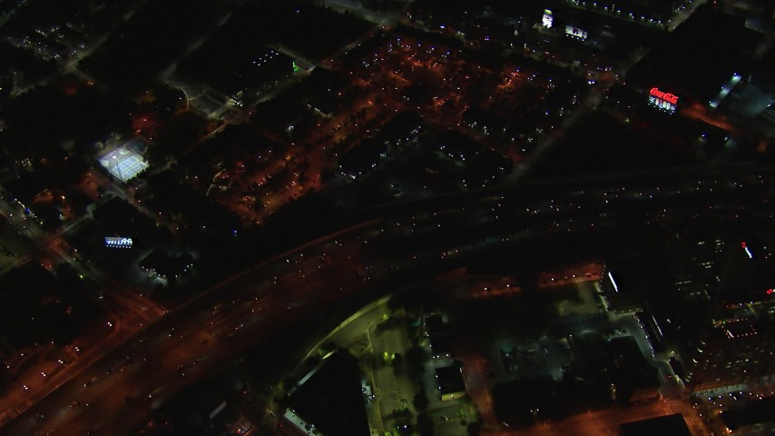 HD stock footage aerial video bird's eye view of I-85 and downtown buildings at night, Downtown Atlanta, Georgia Aerial Stock Footage | CAP_013_109