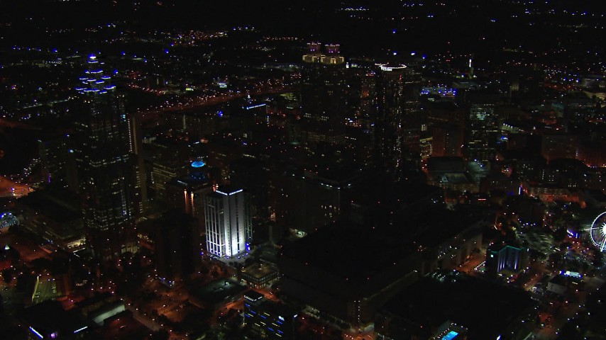 HD stock footage aerial video flying away from the downtown skyline at night, Downtown Atlanta, Georgia Aerial Stock Footage | CAP_013_111