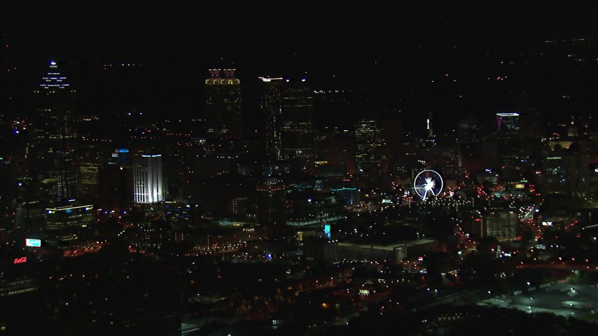 HD stock footage aerial video of a reverse view of the city's downtown skyline at night, Downtown Atlanta, Georgia Aerial Stock Footage | CAP_013_115
