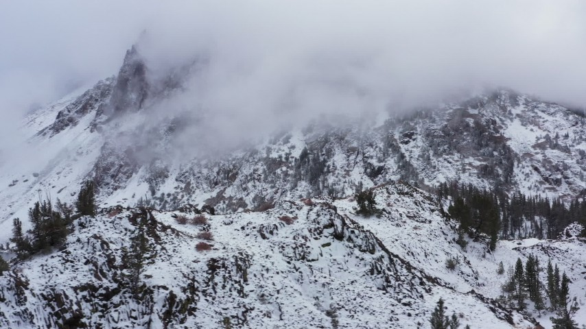 4K stock footage aerial video of passing by a snowy mountain in the Sierra Nevadas, Inyo National Forest, California Aerial Stock Footage | CAP_015_027