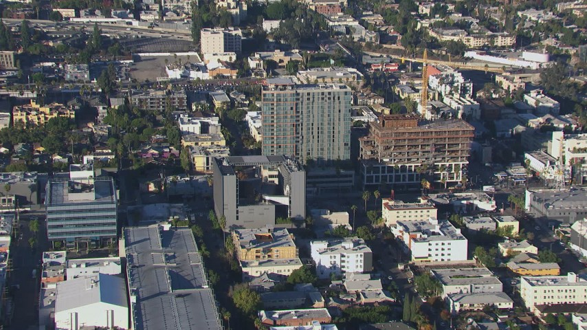 HD stock footage aerial video tilt to and approach college and apartment building in Hollywood, California Aerial Stock Footage | CAP_016_012