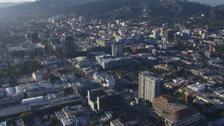 HD stock footage aerial video of flying away from the college and panning across office buildings in Hollywood, California Aerial Stock Footage | CAP_016_015