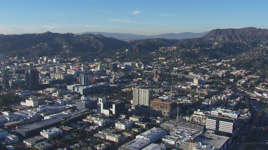 HD stock footage aerial video of flying away from office and city buildings in Hollywood, California Aerial Stock Footage | CAP_016_016
