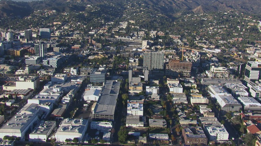 HD stock footage aerial video approach college with Hollywood Sign in the background, California Aerial Stock Footage | CAP_016_017