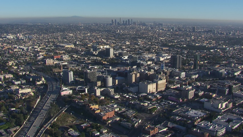 HD stock footage aerial video orbit Hollywood with a view of the Downtown Los Angeles skyline, California Aerial Stock Footage | CAP_016_019