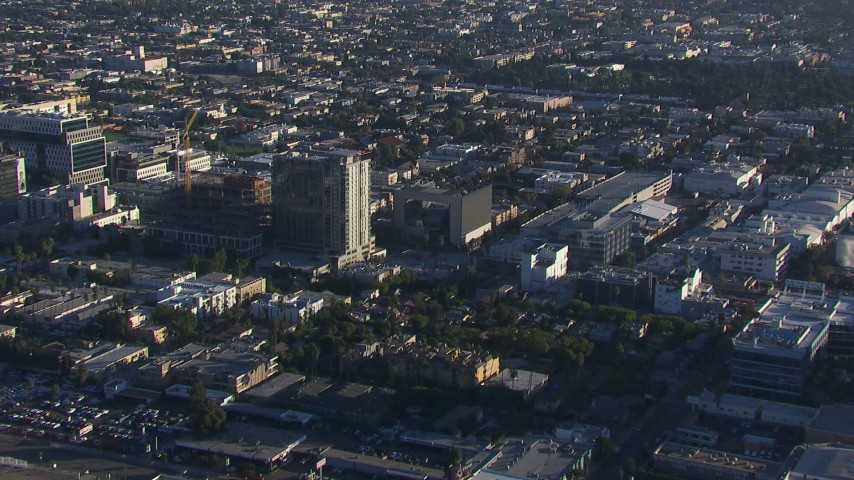 HD stock footage aerial video orbit an approach to apartment and college buildings, Hollywood, California Aerial Stock Footage | CAP_016_021