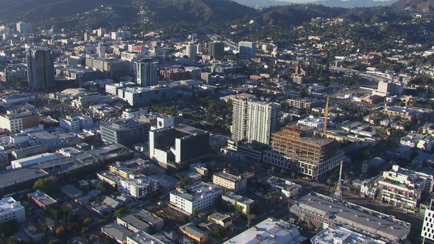 HD stock footage aerial video fly away from Emerson College for a wider view of Hollywood, California Aerial Stock Footage | CAP_016_024