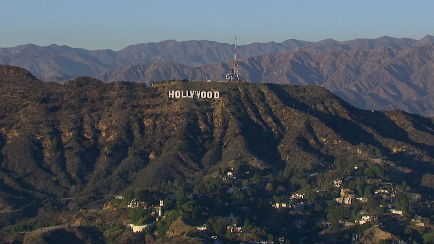 HD stock footage aerial video of flying by the Hollywood Sign in Los Angeles, California Aerial Stock Footage | CAP_016_030