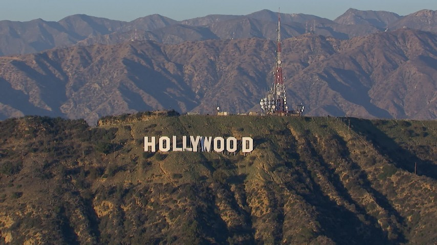 HD stock footage aerial video of the Hollywood Sign and radio towers in Los Angeles, California Aerial Stock Footage | CAP_016_031