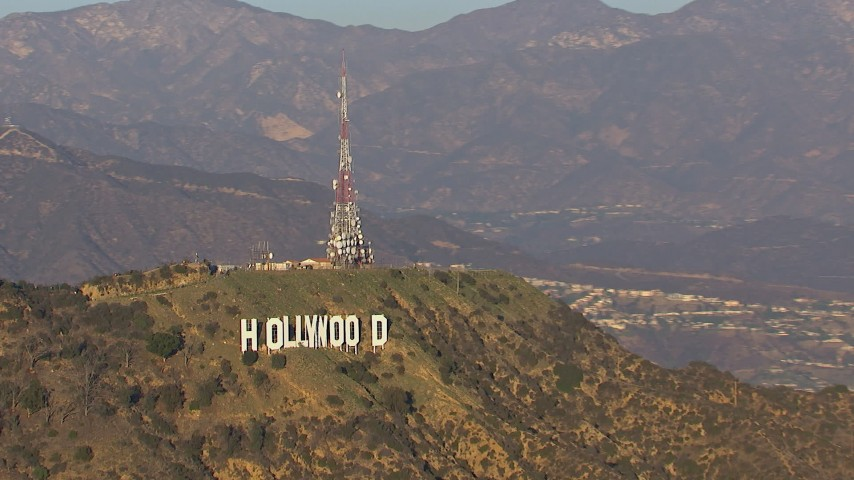 HD stock footage aerial video zoom to wider view of the Hollywood Sign in Los Angeles, California Aerial Stock Footage | CAP_016_033