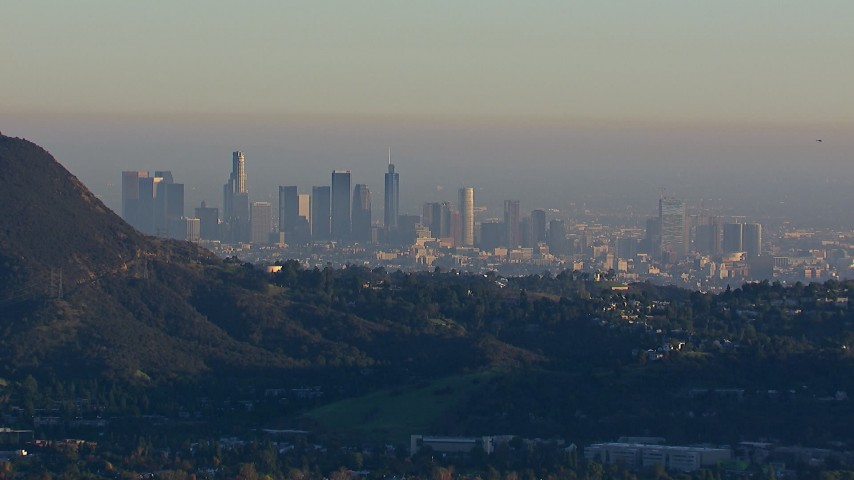 HD stock footage aerial video of a wide view of the city's skyline on a hazy day in Downtown Los Angeles, California Aerial Stock Footage | CAP_016_038