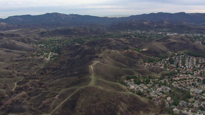 HD stock footage aerial video of flying by suburban homes and burned hills in Malibu, California Aerial Stock Footage | CAP_018_001