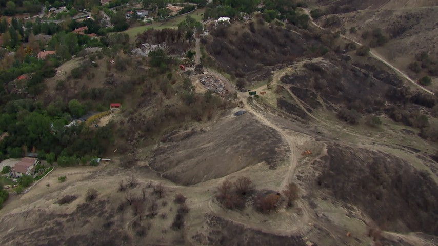 HD stock footage aerial video of flying above burned hills toward destroyed homes in Malibu, California Aerial Stock Footage | CAP_018_004