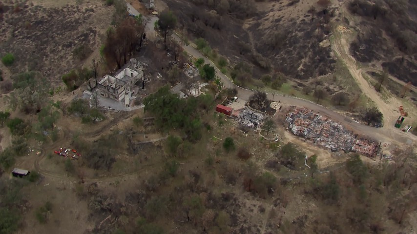 HD stock footage aerial video of a bird's eye view of homes destroyed by fire, Malibu, California Aerial Stock Footage   CAP_018_005