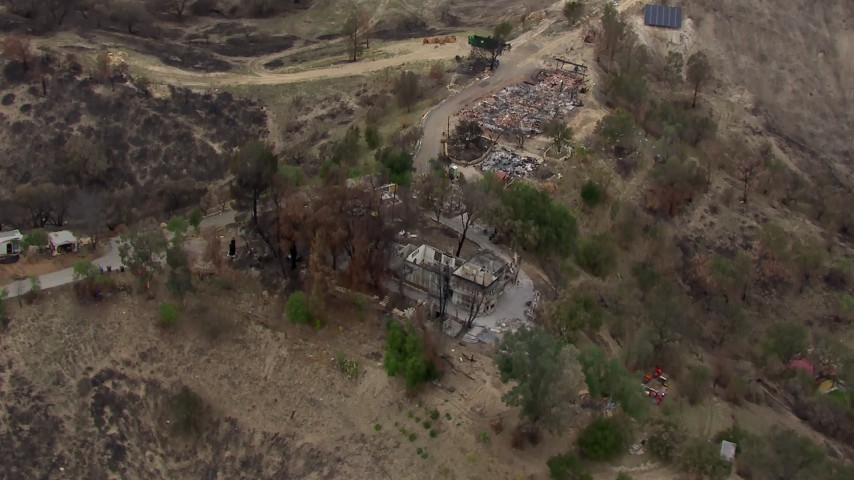 HD stock footage aerial video of orbiting homes destroyed by fire, Malibu, California Aerial Stock Footage | CAP_018_006