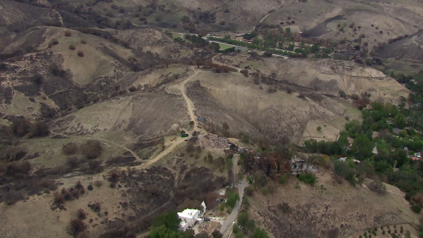 HD stock footage aerial video of flying away from homes and hills destroyed by fire, Malibu, California Aerial Stock Footage | CAP_018_007