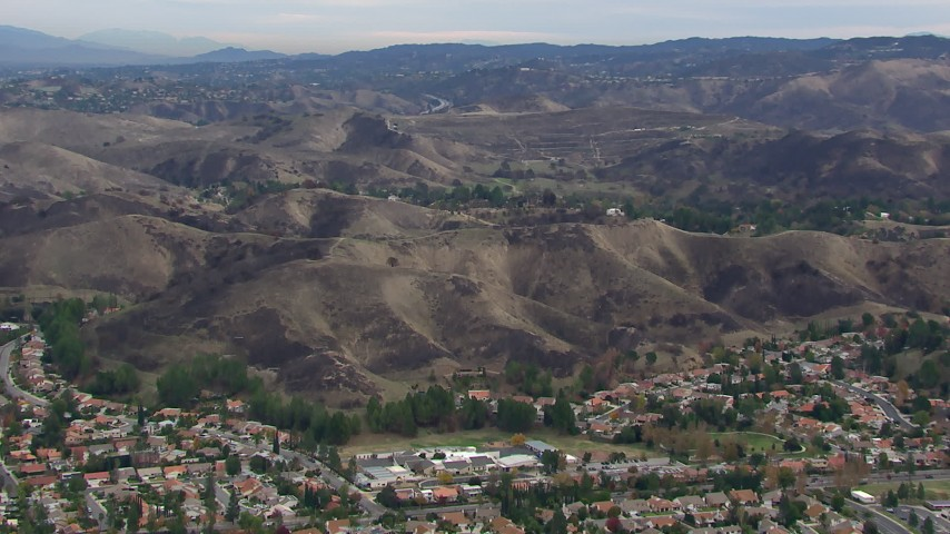 HD stock footage aerial video of an orbit of hills scarred by fire, Malibu, California Aerial Stock Footage | CAP_018_009