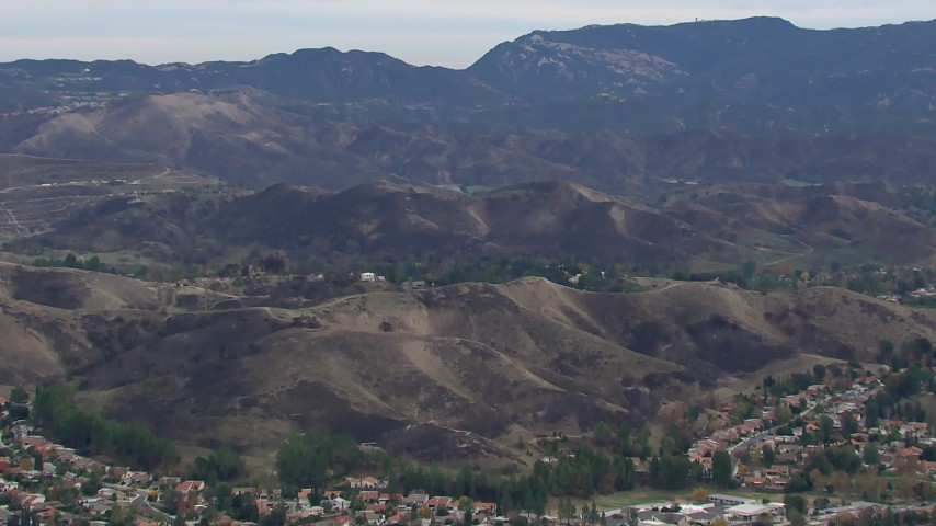 HD stock footage aerial video of a wide view of hills scarred by fire, Malibu, California Aerial Stock Footage | CAP_018_011
