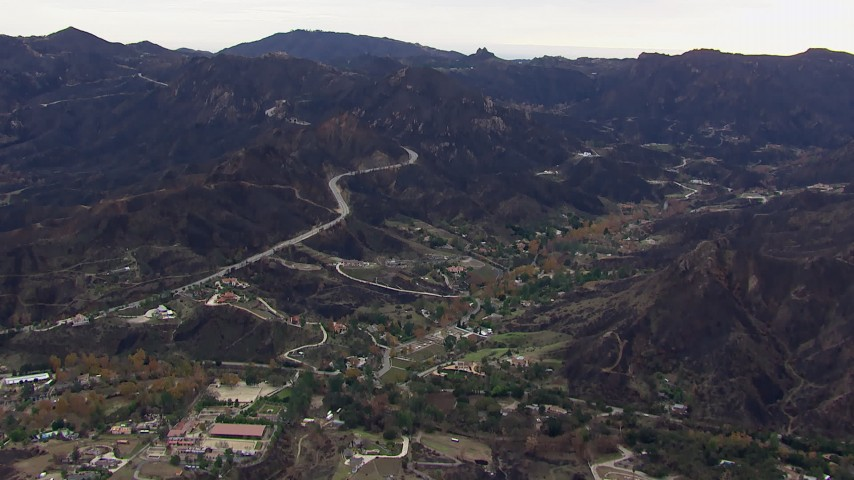 HD stock footage aerial video of approaching mountains and road scarred by fire, Malibu, California Aerial Stock Footage | CAP_018_012