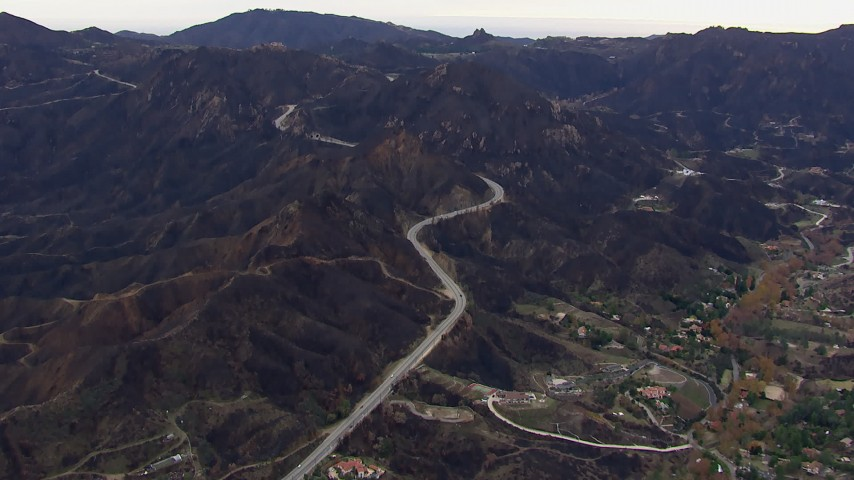HD stock footage aerial video of mountains and road scarred by fire, Malibu, California Aerial Stock Footage | CAP_018_013