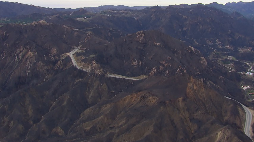 HD stock footage aerial video of road and tunnels by mountains scarred by fire, Malibu, California Aerial Stock Footage | CAP_018_015