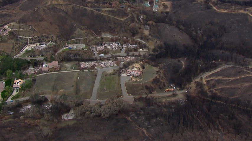 HD stock footage aerial video of approaching homes destroyed by fire, Malibu, California Aerial Stock Footage | CAP_018_020